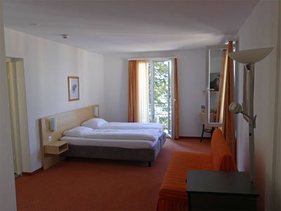 The lakeview minisuite at the Hotel Rigi Vitznau is a spacious corner room en suite with balcony